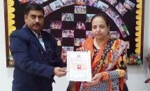 Dr. S.B. Sharma presenting Life Membership to Dr. Anita Menon, Principal, D.A.V. College of Education, Amritsar